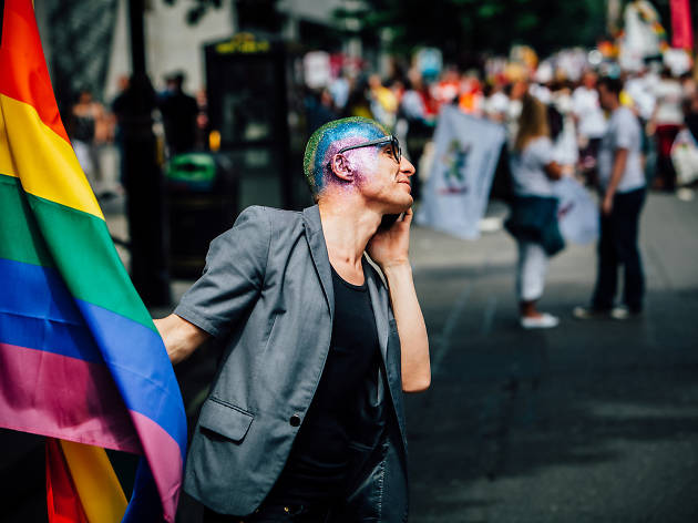 Man with rainbow flag at Pride London