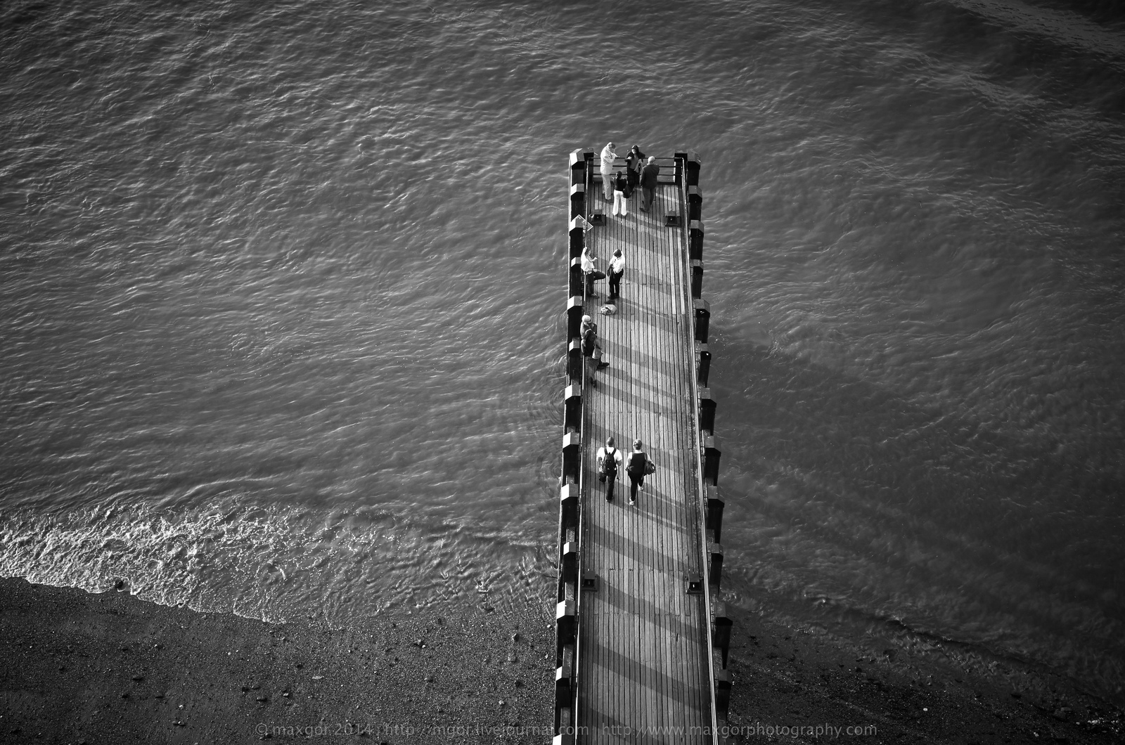 A pier from South Bank juts out into the Thames, London