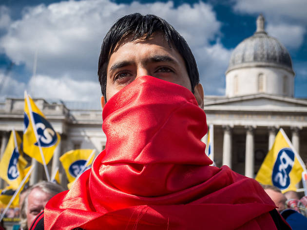 A protestor on May Day in Trafalgar Square, London