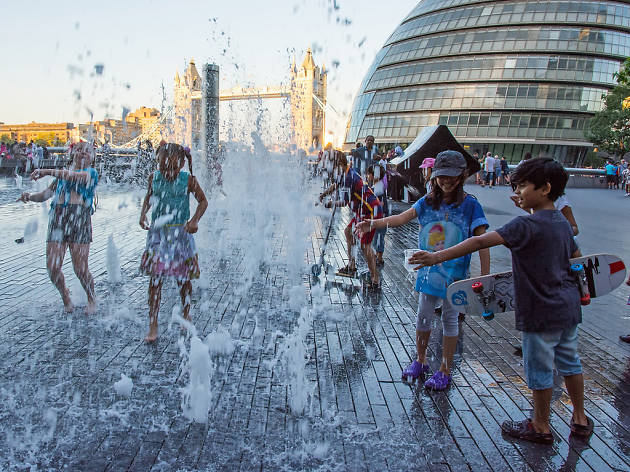 Children play in fountains by City Hall, London