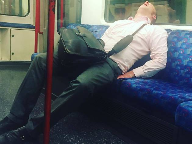 Man asleep on the Tube
