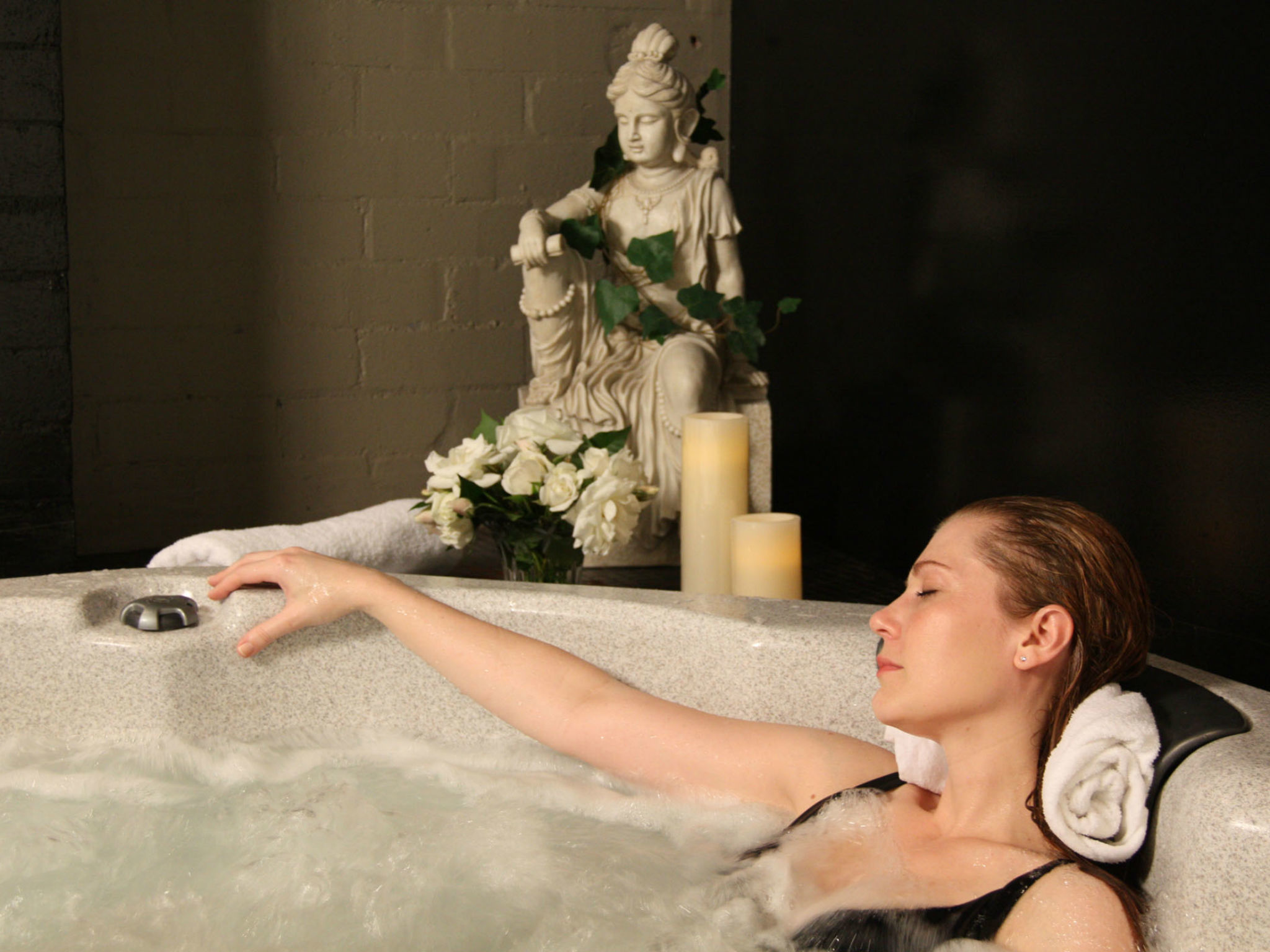 Woman relaxing in spa bath