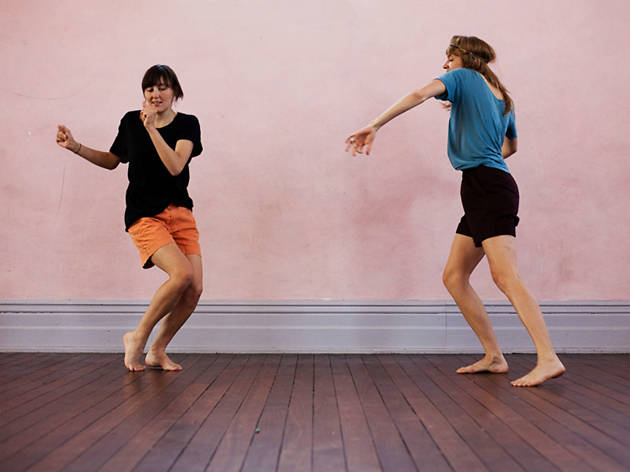 Two women dancing in a room
