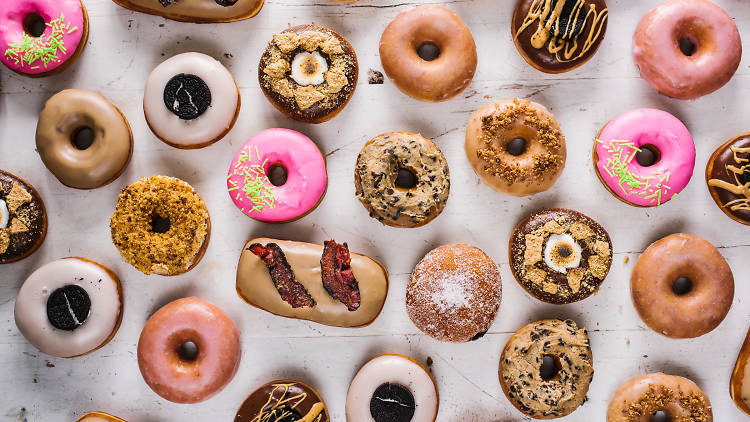 A variety of donuts laid out over a table
