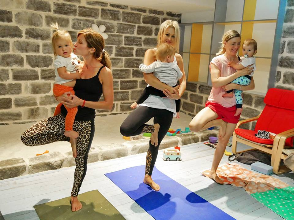 Three women in yoga positions at the Salt Rooms