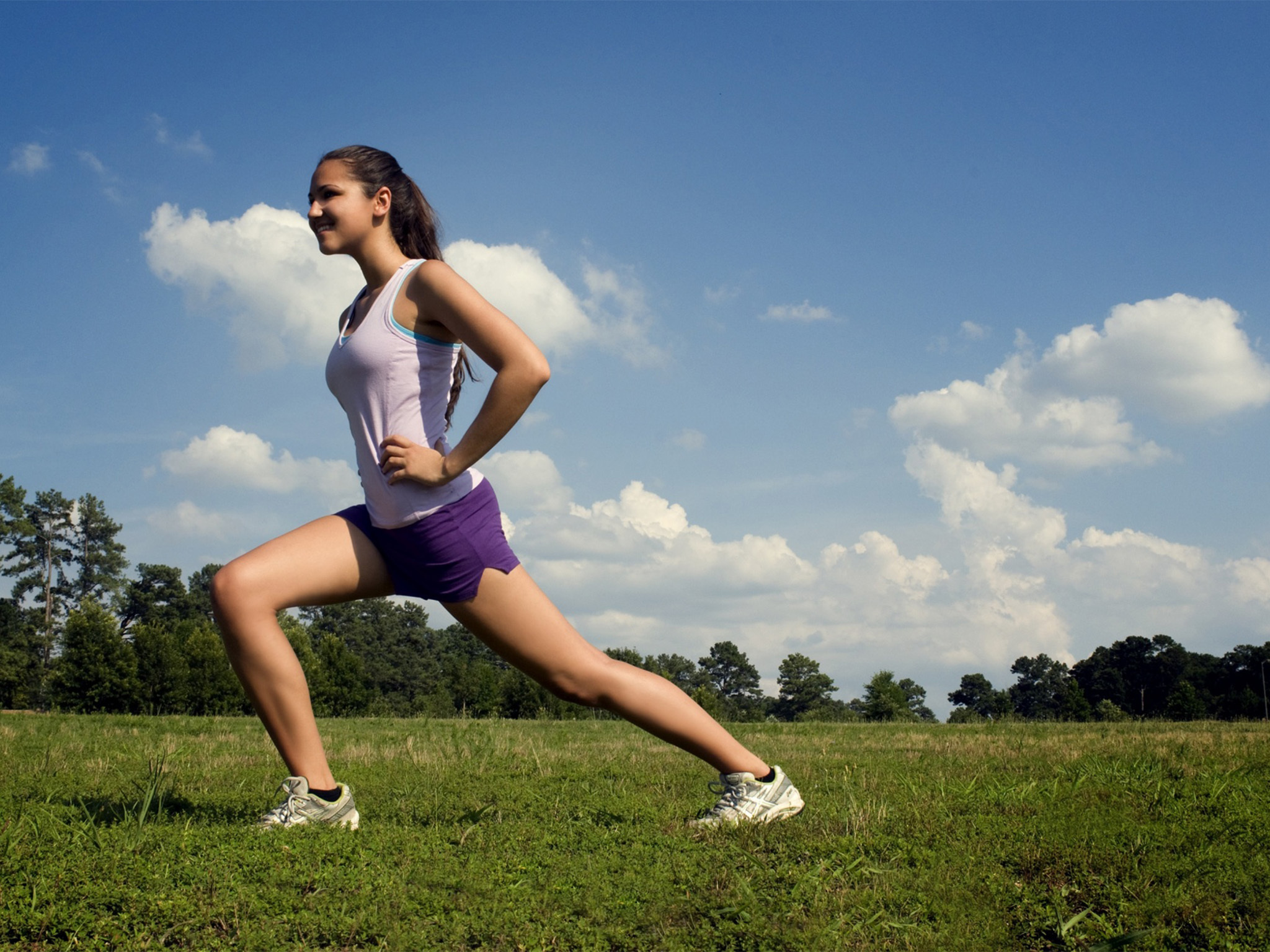 Generic woman running on grass