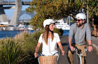 Man and woman cycling at Glebe foreshore