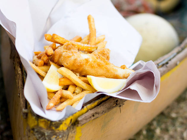 A stock photo of fried fish and chips in paper
