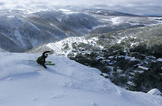 Skiier carves up the snow overlooking Falls Creek ski resort