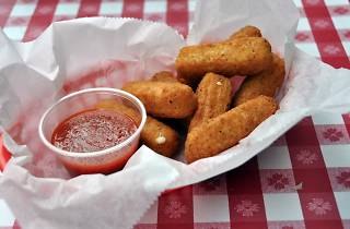 Fried cheese straws  on a red checker table cloth