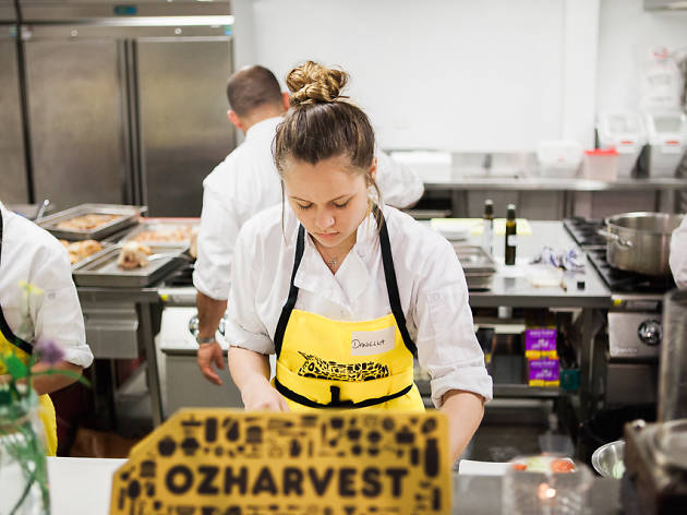 Chef cooking in ozharvest apron