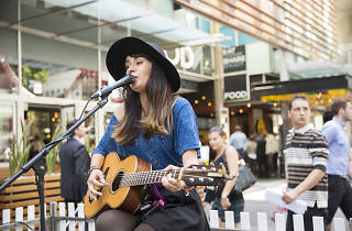 A busker performs at the 2014 Time Out Hop Up in Sydney