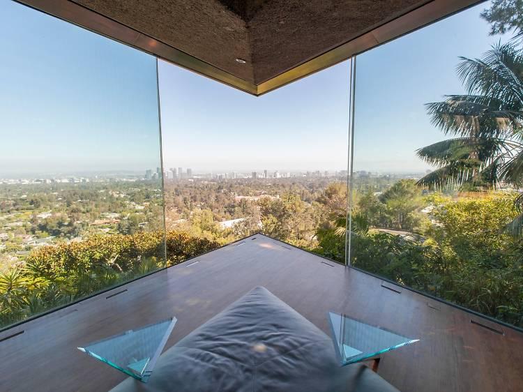 The master bedroom's retracting glass walls