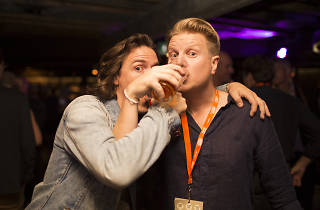 Two people drinking beer at the festival