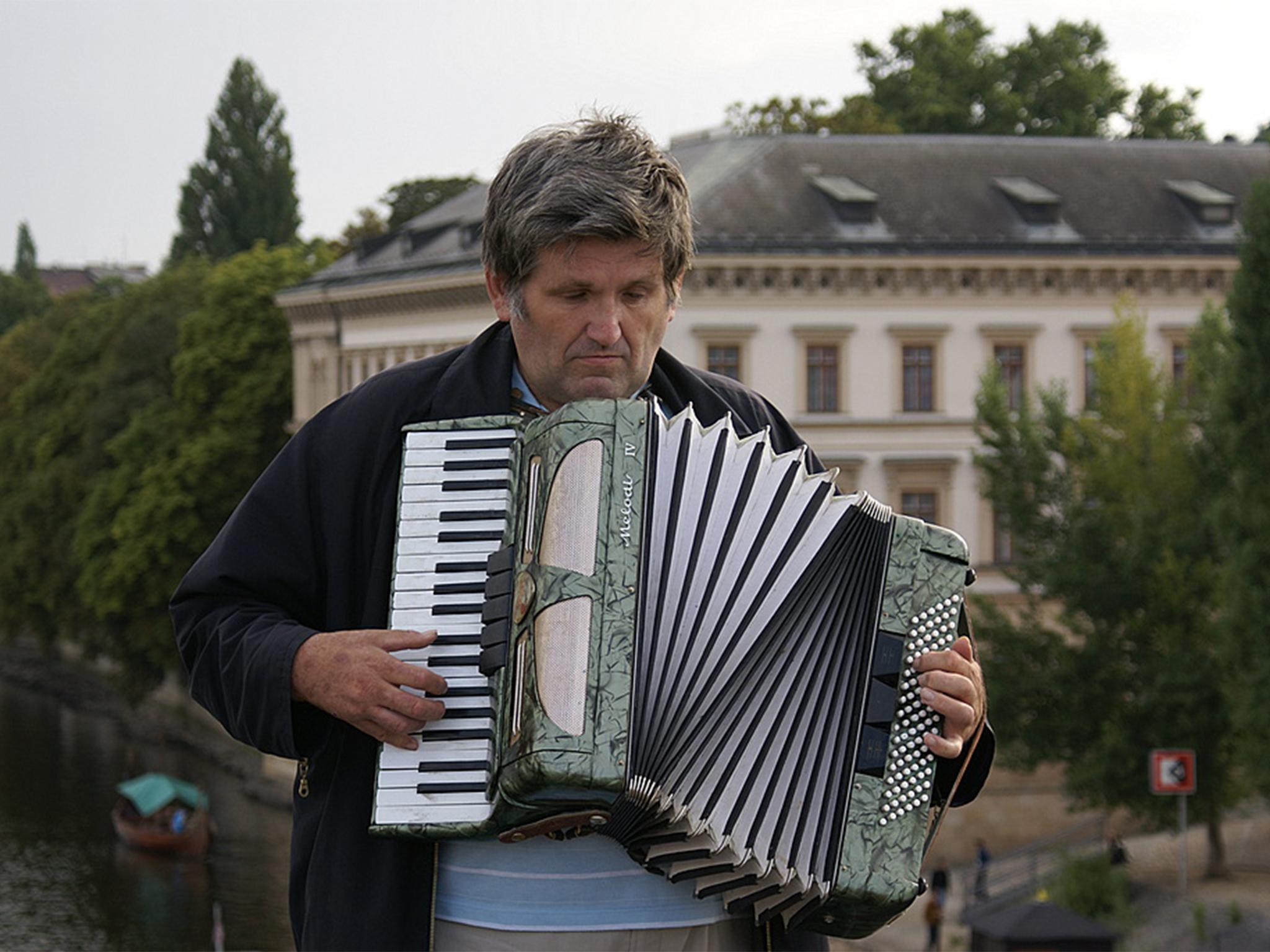 Man plays an accordion