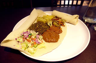 Injera flatbread with five kinds of curried vegetables and salad served on top at Blue Nile African Cuisine and Cafe