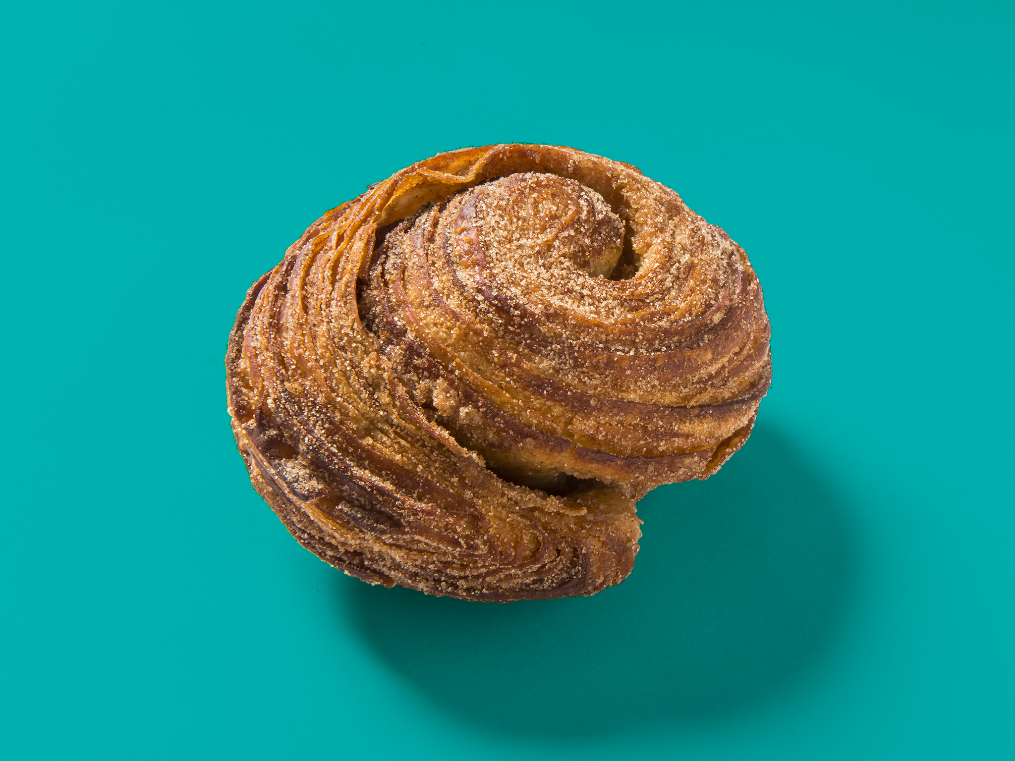 Kouign amann pastry on a turquoise background