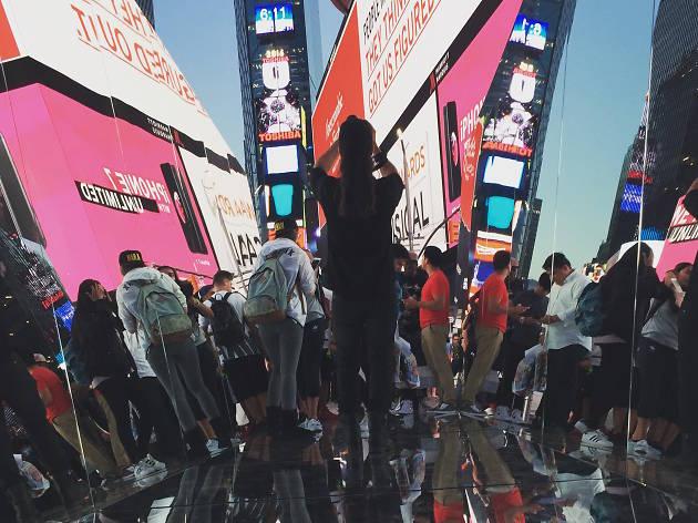 Walk inside the human kaleidoscope artwork in Times Square