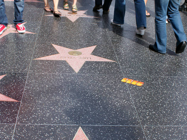 Man with sledgehammer smashes Donald Trumps Walk of Fame star