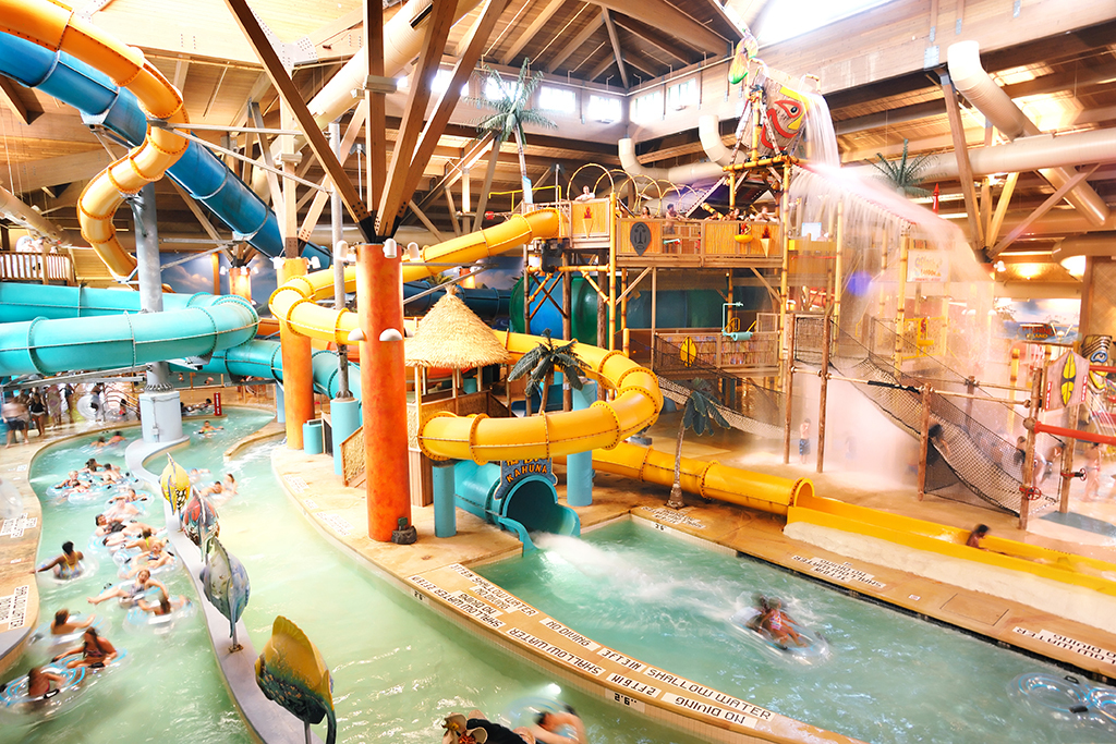 Indoor pool with waterslide  Best indoor water parks in America with lazy rivers and slides
