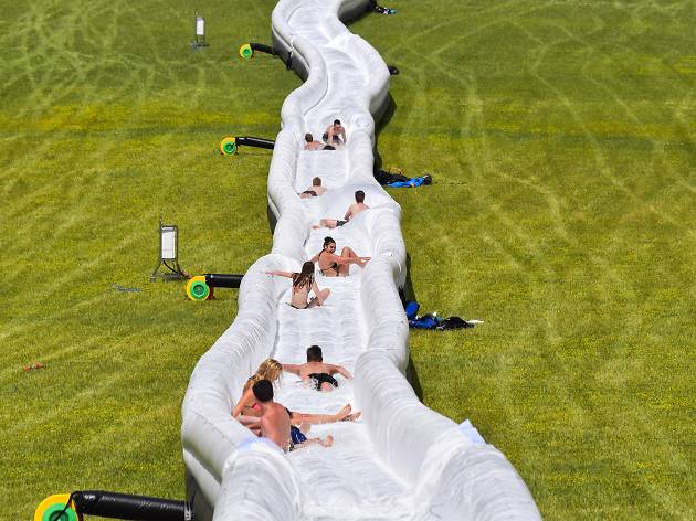 People on a giant water slide