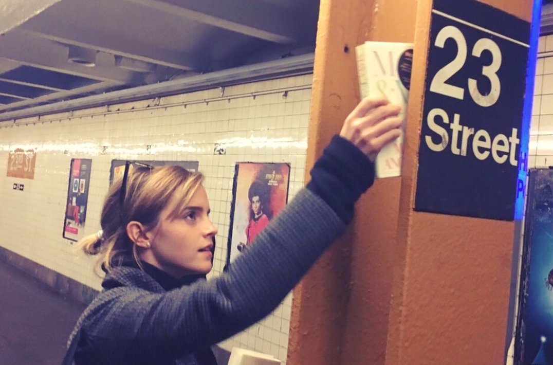 Emma Watson is hiding feminist books on the NYC subway today