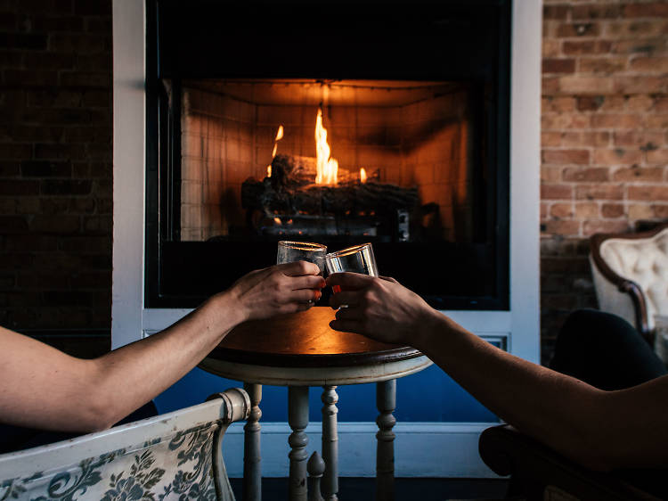 Cozy up at a fireplace bar