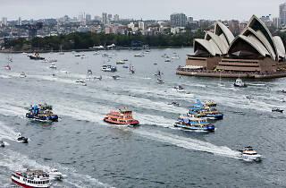 Ferries racing in Sydney Harbour.