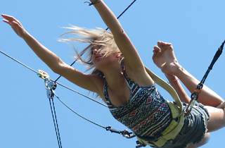 Woman doing a trapeze workshop