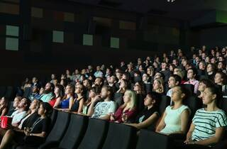 Movie goers in a cinema watching a movie
