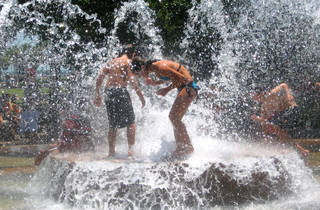 People playing in the water fountain at a a water park