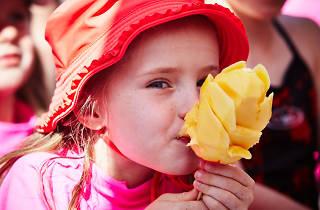 Girl eating mango