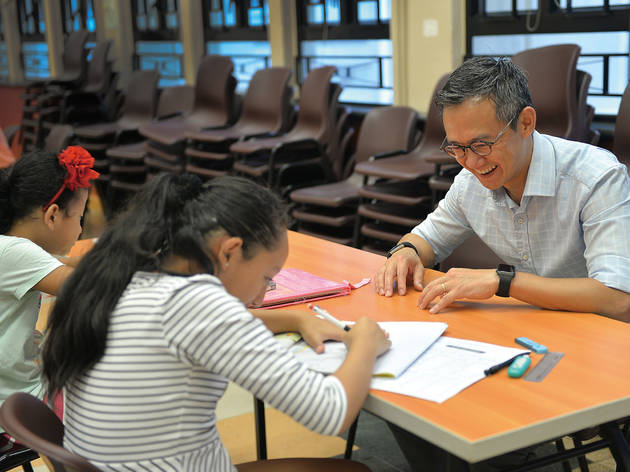 A volunteer helping ethnic minority students