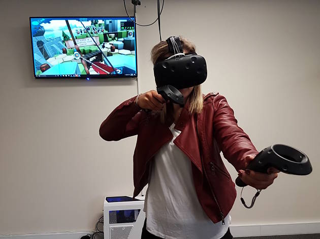 Woman at Black Site VR wearing virtual reality headset