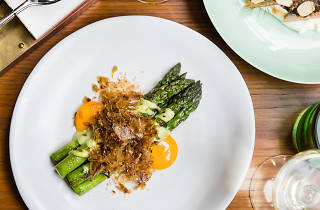 a plate of asparagus and eggs