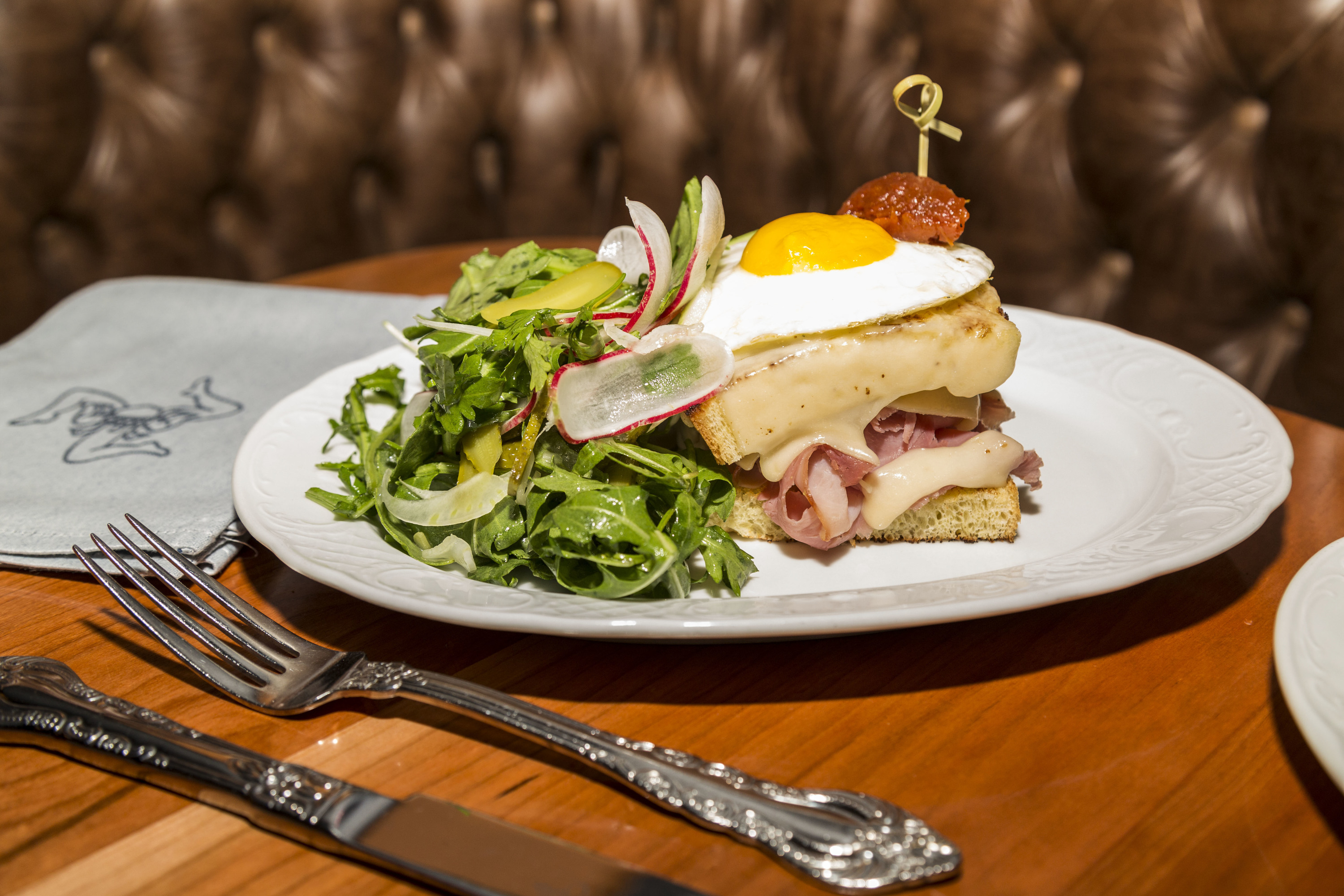 Open-faced fried egg and ham sandwich at Cherry Circle Room
