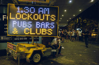 """Lockout sign reading """"1.30am lockouts pubs, bars and clubs"""""""