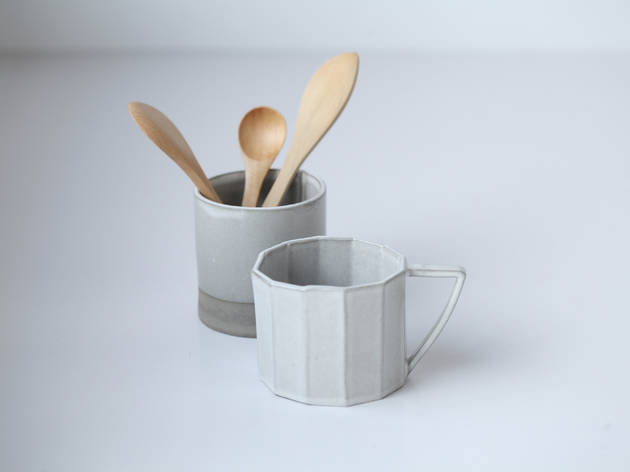 Ceramic cup, wooden spoon and wooden butter spreader