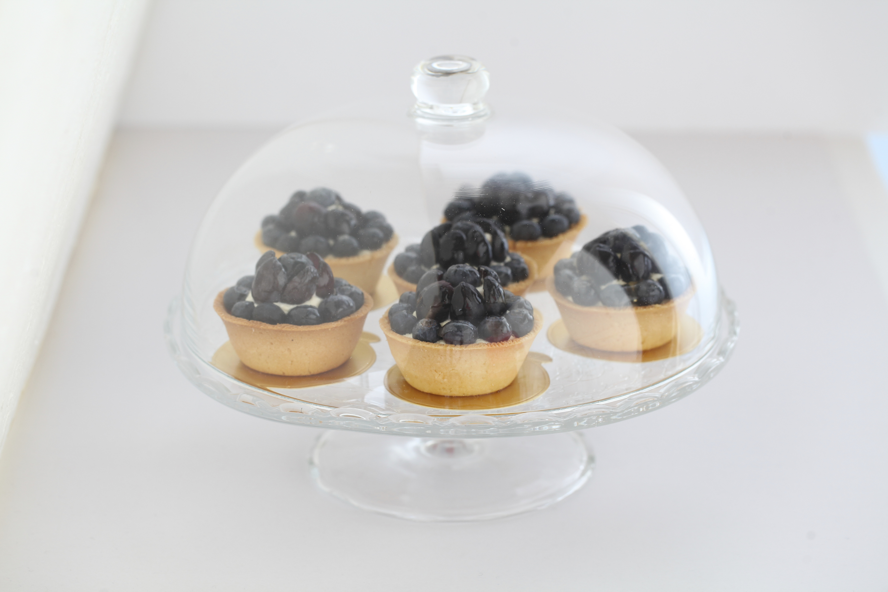 Blueberry tarts and serving stand