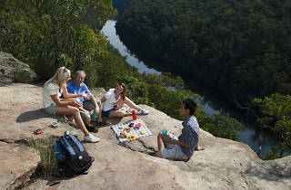 People having a picnic on a rock above the Nepean River