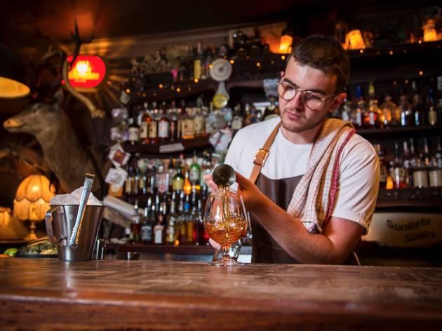 Bartender preparing cocktails at Shady Pines