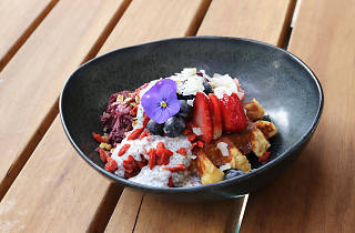 A waffle with a selection of autumn fruits