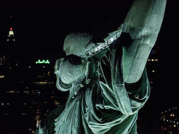 Check out these breathtaking nighttime photos of the Statue of Liberty