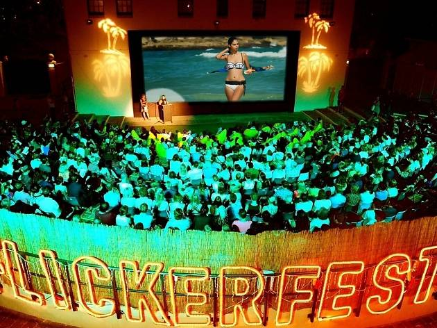 Flickerfest amphitheater shows a woman at the beach on screen