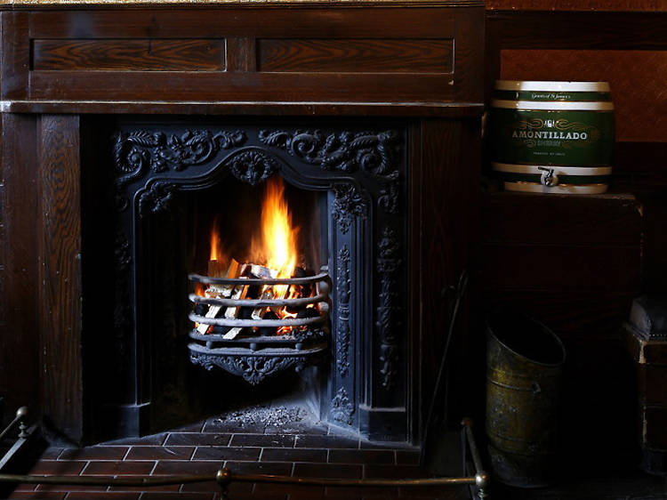 Grab a seat by the fire at The Holly Bush