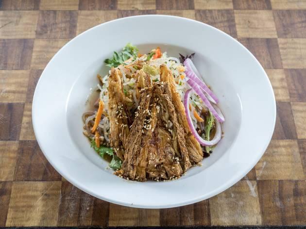 Fried tofu and noodle dish at Nourishing Quarter