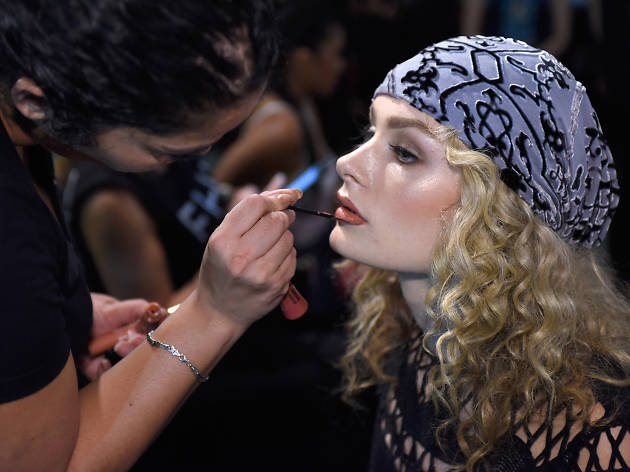 A model prepares backstage before the Hale Bob show at Art Hearts Fashion NYFW The Shows presented by AIDS Healthcare Foundation at The Angel Orensanz Foundation on September 12, 2016