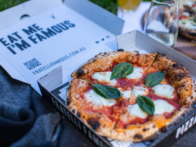 A Margherita pizza in a box