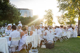 A long table of guests at Le Diner en Blanc