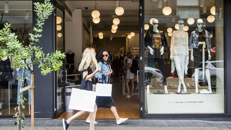 Two women walking down Gould Street holding shopping bags